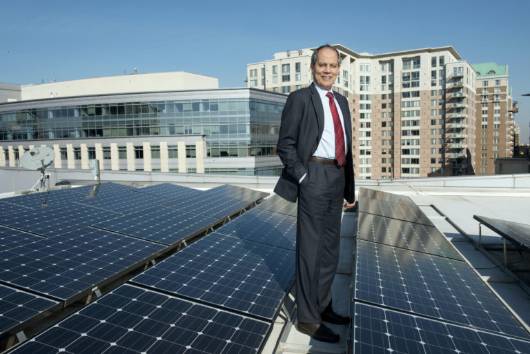 Saifur Rahman, Advanced Research Institute, with his photovoltaic installation on the roof of Virginia Tech's Arlington Research Center in Arlington, VA.